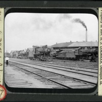 [Steam engines on the tracks in the Milwaukee Railroad yards]