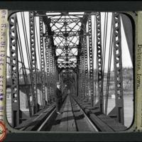 [On a railroad bridge crossing the Mississippi River]
